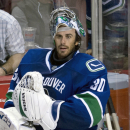 Vancouver Canucks goalie Ryan Miller prepares to leave the bench following the Canucks loss to the Arizona Coyotes in Vancouver, British Columbia, Monday, Sept. 29, 2014 The Associated Press