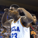 UCLA forward Tony Parker, left, flexes after scoring as Southern California forward Malik Martin, right, walks away during the second half of an NCAA college basketball game, Wednesday, March 4, 2015, in Los Angeles. UCLA won 85-74. (AP Photo/Mark J. Terrill)