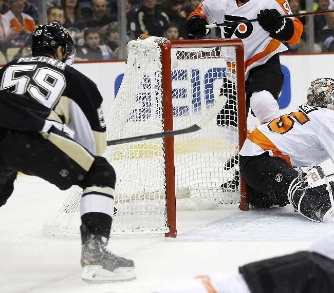 Pittsburgh Penguins' Jayson Megna (59) scores on Philadelphia Flyers goalie Steve Mason (35) during the second period of an NHL hockey game on Sunday, March 16, 2014, in Pittsburgh