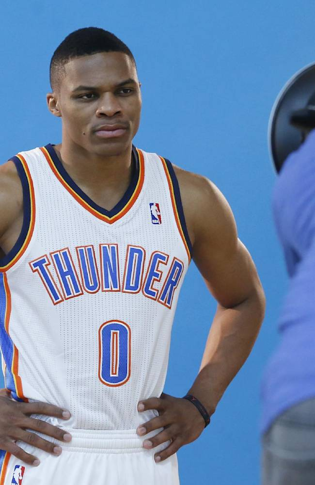 Oklahoma City Thunder guard Russell Westbrook has his photo taken during media day for the NBA basketball team in Oklahoma City, Friday, Sept. 27, 2013