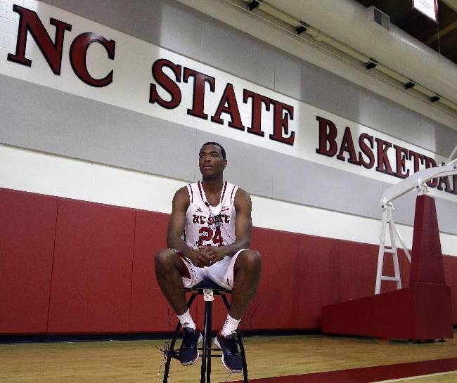 North Carolina State's T.J. Warren listens to a question while being interviewed during the team's NCAA college basketball media day in Raleigh, N.C., Monday, Sept. 30, 2013