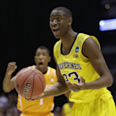 Michigan's Caris LeVert reacts to a call during the second half of an NCAA Midwest Regional semifinal college basketball tournament game against the Tennessee Friday, March 28, 2014, in Indianapolis. (AP Photo/David J. Phillip)