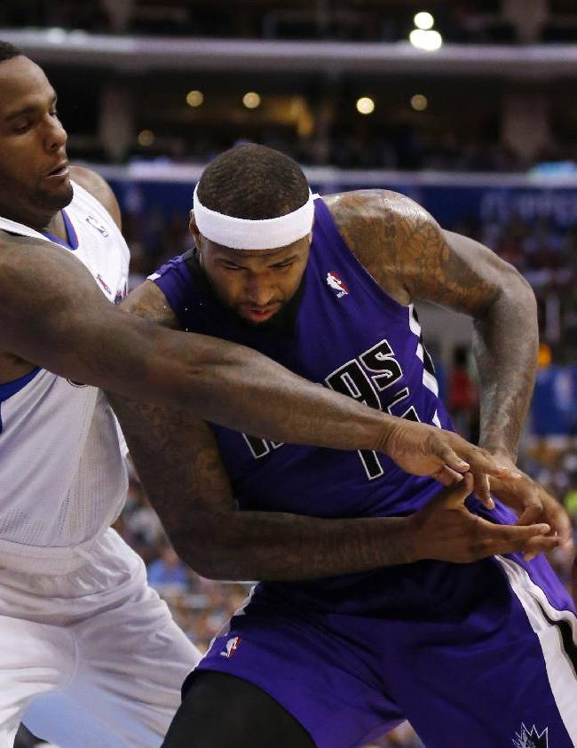 Sacramento Kings center DeMarcus Cousins, right, loses the ball as he is fouled by Los Angeles Clippers forward Glen Davis, left, during the second half of an NBA basketball game in Los Angeles, Saturday, April 12, 2014. The Clippers won 117-101