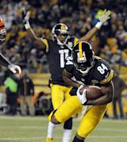 Pittsburgh Steelers wide receiver Antonio Brown (84) goes in for a touchdown as wide receiver Markus Wheaton (11) celebrates in the first quarter of an NFL football game against the Cincinnati Bengals on Sunday, Dec. 15, 2013, in Pittsburgh. (AP Photo/Don Wright)
