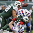 In this Oct. 26, 2014, file photo, New York Jets quarterback Michael Vick (1) is sacked by Buffalo Bills' Mario Williams (94) and Kyle Williams (95) during the first half of an NFL football game in East Rutherford, N.J. For those who believe the guys who