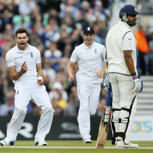 England's James Anderson, left, celebrates after taking the wicket of India's Murali Vijay, right, LBW, during the third day of the fifth test cricket match at Oval cricket ground in London, Sunday, Aug. 17, 2014