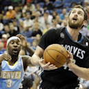 Minnesota Timberwolves' Kevin Love, right, eyes the basket in front of Denver Nuggets's Ty Lawson in the first quarter of an NBA basketball game on Wednesday, Nov. 27, 2013, in Minneapolis The Associated Press