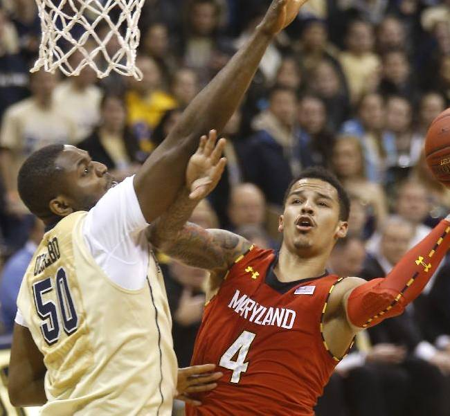 Maryland's Seth Allen (4) puts up a shot around Pittsburgh's Joseph Uchebo (50)in the second half of an NCAA college basketball game on Monday, Jan. 6, 2014, in Pittsburgh. Pittsburgh won 79-59