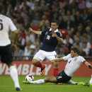 England's Steven Gerrard, center right, slides in to tackle Scotland's Robert Snodgrass during their international friendly soccer match between England and Scotland at Wembley Stadium in London, Wednesday, Aug. 14, 2013. (AP Photo/Alastair Grant)
