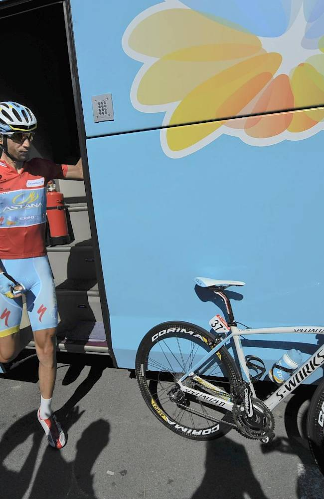 Vincenzo Nibali of Italy, overall leader of the Spanish La Vuelta Cycling, leaves his official bus before the  start of the 181 kilometer (19th stage of the Vuelta cycling race, a 181-kilometer (112,5-mile) leg between San Vicente de La Barquera and Oviedo, in San Vicente de La Barquera, northern Spain, Friday, Sept. 13, 2013