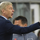 Arsenal's head coach Arsene Wenger, who celebrated his birthday, gives directions to his players during the Group D Champions League match between Anderlecht and Arsenal at Constant Vanden Stock Stadium in Brussels, Belgium, Wednesday Oct. 22, 2014. Arsen