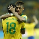Brazil's Paulinho, left, is congratulated by his teammate Neymar after scoring his side's 2nd goal during the soccer Confederations Cup semifinal match between Brazil and Uruguay at the Mineirao stadium in Belo Horizonte, Brazil, Wednesday, June 26, 2013. (AP Photo/Bruno Magalhaes)