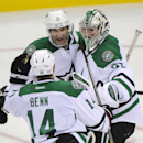 Dallas Stars' Erik Cole (72), Jamie Benn (14) and Kari Lehtonen, of Finland, celebrate after they defeated the New Jersey Devils 3-2 in a shootout at an NHL hockey game Friday, Oct. 24, 2014, in Newark, N.J The Associated Press