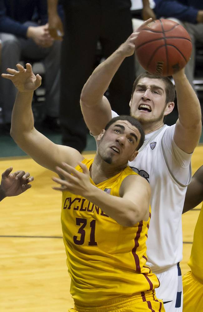 Iowa State forward Georges Niang (31) and Akron center Pat Forsythe, top, battle for a rebound in the first half of an NCAA college basketball game at the Diamond Head Classic, Monday, Dec. 23, 2013, in Honolulu