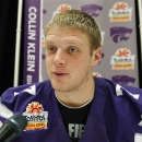 Kansas State quarterback Collin Klein answers questions during media day for the Fiesta Bowl NCAA college football game, Monday, Dec. 31, 2012, in Scottsdale, Ariz. Kansas State is scheduled to play Oregon on Jan. 3, 2013, in Glendale. (AP Photo/Paul Connors)