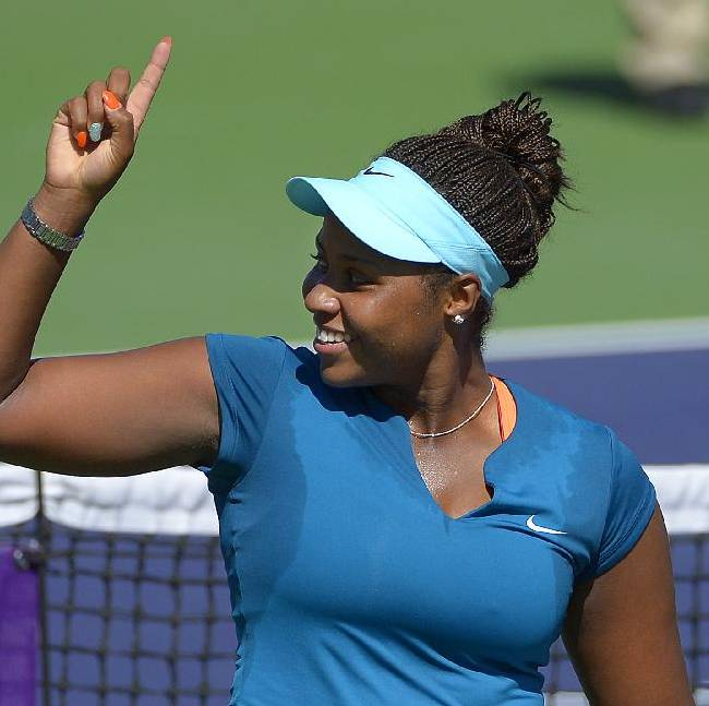 Taylor Townsend celebrates after beating Karin Knapp, of Italy, in a first round match at the BNP Paribas Open tennis tournament, Thursday, March 6, 2014, in Indian Wells, Calif. Townsend won 7-6, 6-1