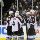 Colorado Avalanche's Ryan O'Reilly (90), Tyson Barrie (4), Erik Johnson (6) and Matt Duchene (9) celebrate Duchene's second goal in the second period of an NHL hockey game against the New York Islanders on Saturday, Feb. 8, 2014, in Uniondale, N.Y The Ass