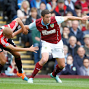 Burnley's Lukas Jutkiewicz, right, is challenged by Sunderland's Wes Brown during the English Premier League soccer match at Turf Moor, Burnley, England, Saturday Sept. 20, 2014
