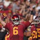 Southern California quarterback Cody Kessler, left, celebrates a touchdown during the first half of an NCAA college football game against Colorado, Saturday, Oct. 18, 2014, in Los Angeles. (AP Photo/Mark J. Terrill)