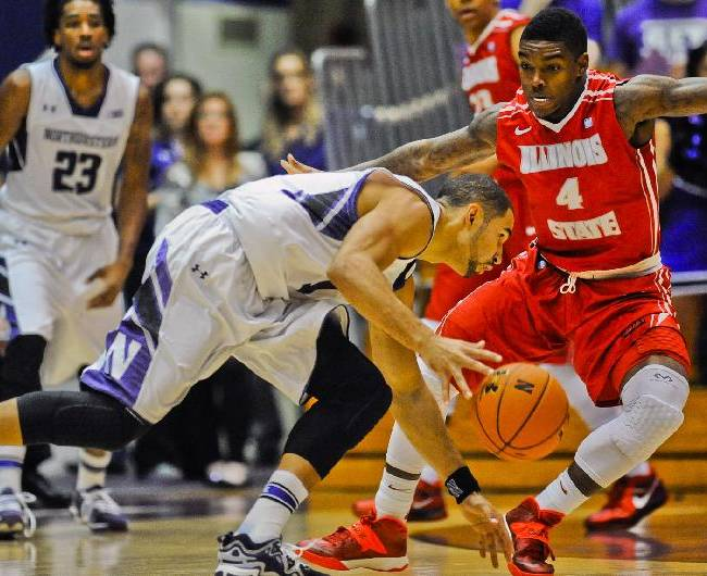 Northwestern's Drew Crawford, left, dribbles past Illinois State's Bobby Hunter during the first half of an NCAA college basketball game in Evanston, Ill., on Saturday, Nov. 17, 2013
