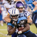 Tennessee Titans running back Antonio Andrews is tackled by Minnesota Vikings linebacker Mike Zimmer during the Tennessee Titans' 19-3 preseason loss to the Minnesota Vikings at LP Field on Thursday, Aug. 28, 2014 The Associated Press