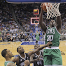 Boston Celtics' Brandon Bass (30) puts up a shot over Orlando Magic's E'Twaun Moore, second from left, and Andrew Nicholson (44) as teammate Courtney Lee, left, looks on during the second half of an NBA basketball game in Orlando, Fla., Friday, Nov. 8, 20