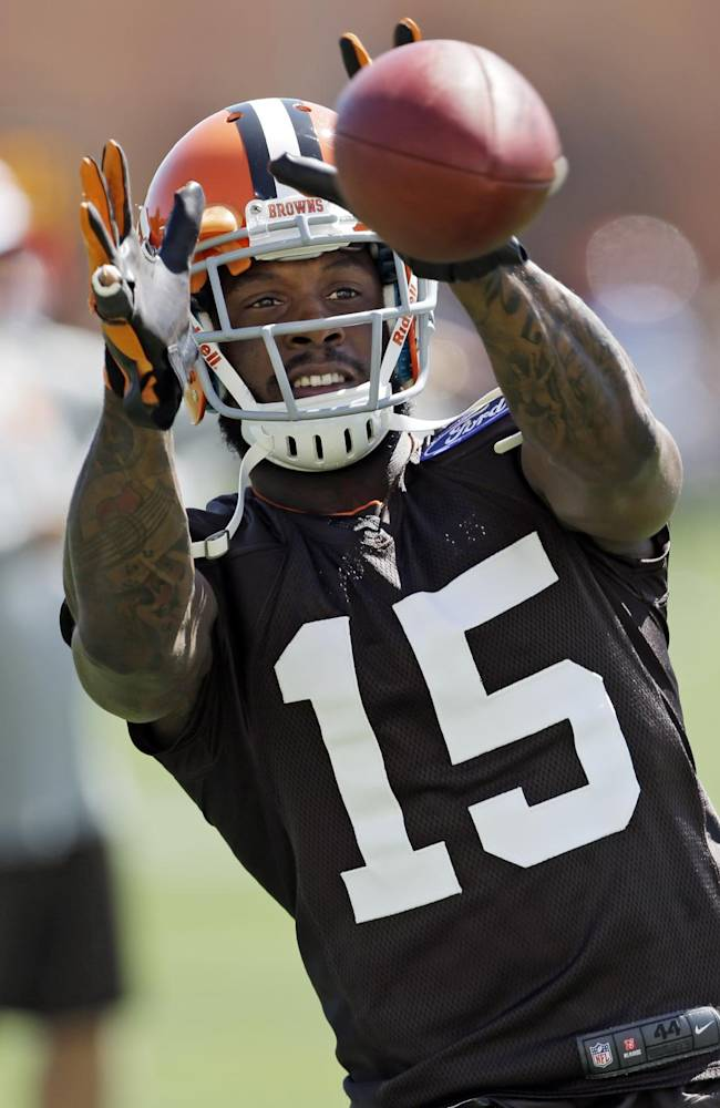 Cleveland Browns wide receiver Davone Bess catches a pass during training camp at the NFL football team's practice facility in Berea, Ohio, Thursday, July 25, 2013