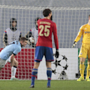 Manchester City's James Milner, left, celebrates after scoring the second goal during the Champions League Group E soccer match between CSKA Moscow and Manchester City at Arena Khimki stadium in Moscow, Russia, Tuesday Oct. 21, 2014