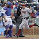 Arizona Diamondbacks' Tony Campana, right, scores on a single hit by Mike Bolsinger as Chicago Cubs catcher Welington Castillo looks down during the second inning of a baseball game in Chicago, Thursday, April 24, 2014 The Associated Press