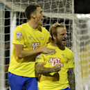 Derby's Johnny Russell celebrates with Craig Forsyth, left, after scoring a goal during the English League Cup soccer match between Fulham and Derby County at Craven Cottage stadium in London, Tuesday, Oct. 28, 2014