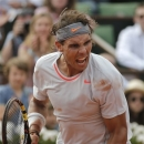 Spain's Rafael Nadal reacts after defeating Switzerland's Stanisas Wawrinka during their quarterfinal match of the French Open tennis tournament at the Roland Garros stadium Wednesday, June 5, 2013 in Paris. Nadal won 6-2, 6-3, 6-1. (AP Photo/Christophe Ena)