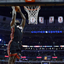 Miami Heat's Lebron James (6) goes up for a dunk during the fourth quarter of an NBA basketball game against the Chicago Bulls in Chicago, Sunday, March 9, 2014. The Bulls won 95-88 in overtime The Associated Press