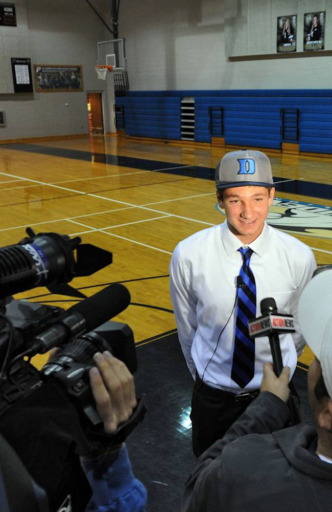 Wednesday  Nov. 13, 2013 is the first day of the NCAA early signing period, where kids in all sports other than football can sign with their college. Leading the way is Jacksonville, FL Providence School's guard Grayson Allen, who becomes just the fourth player from the state to sign with Duke University since Mike Krzyzewski became coach in 1980. After signing, Grayson Allen is interviewed by two local TV stations in the school's gym