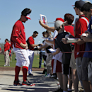 Washington Nationals starting pitchers Stephen Strasburg, left, and Washington Gio Gonzalez sign autographs for fans after a spring training baseball workout, Monday, Feb. 17, 2014, in Viera, Fla The Associated Press