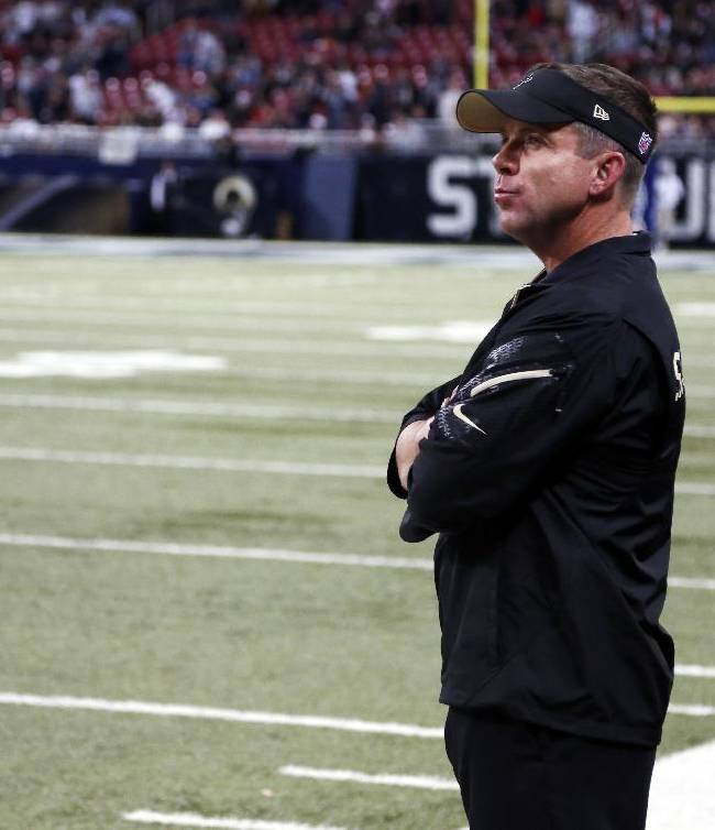 New Orleans Saints head coach Sean Payton watches from the sidelines during closing seconds of an NFL football game against the St. Louis Rams Sunday, Dec. 15, 2013, in St. Louis. The Rams won 27-16