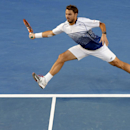 Stan Wawrinka of Switzerland stretches out for a return to Novak Djokovic of Serbia during their semifinal at the Australian Open tennis championship in Melbourne, Australia, Friday, Jan. 30, 2015. (AP Photo/Lee Jin-man)