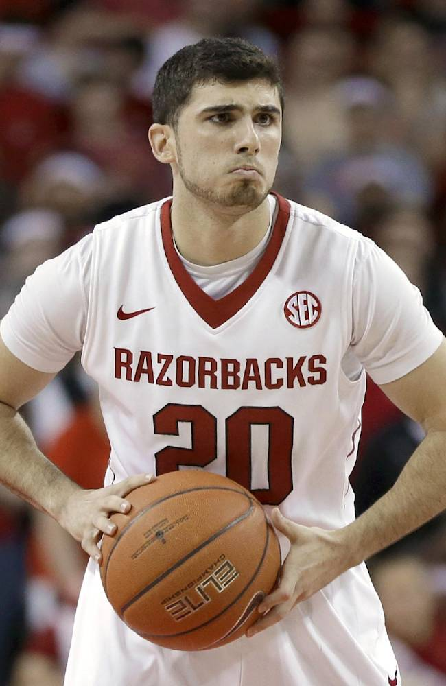 In this photo taken March 5, 2014, Arkansas guard Kikko Haydar plays in the first half of an NCAA college basketball game against Mississippi in Fayetteville, Ark. The senior guard has signed a contract to play professional basketball in his home country of Lebanon after he graduates the University of Arkansas announced Tuesday, April 8, 2014