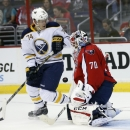 Washington Capitals goalie Braden Holtby (70) deflects a shot with Buffalo Sabres left wing Vaclav Karabacek (74) nearby, in the second period of a preseason NHL hockey game, Sunday, Sept. 21, 2014, in Washington The Associated Press
