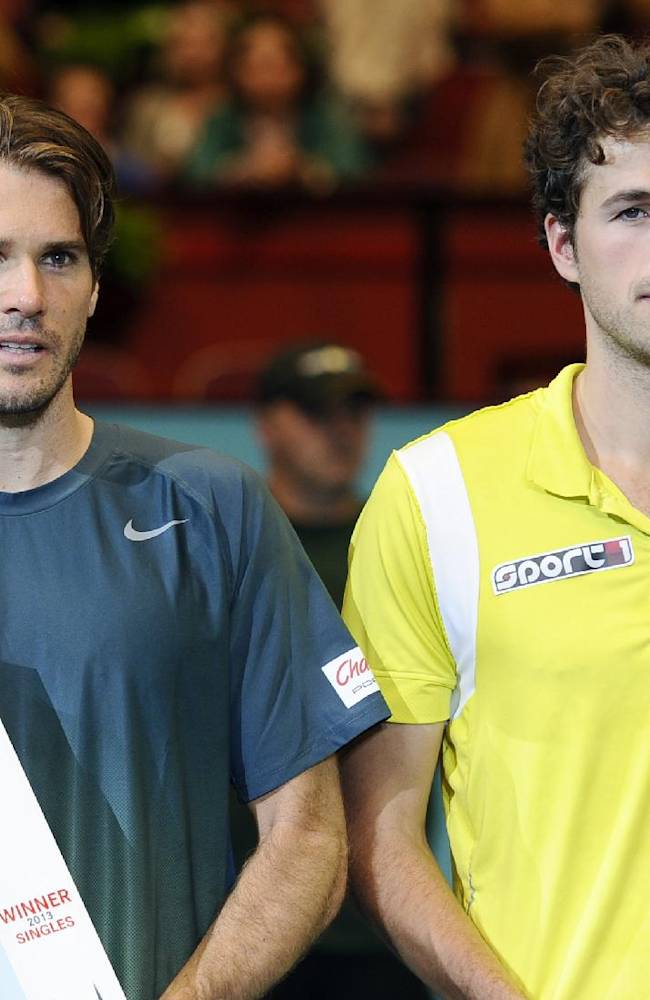 Winner Tommy Haas of Germany, left, and Robin Haase of the Netherlands pose with their trophies after the final match at the Erste Bank Open tennis tournament in Vienna, Austria, Sunday, Oct. 20, 2013