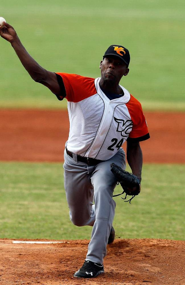 Cuba pitcher Vicyhandri Odelin throws a ball in the first inning of a Caribbean Series baseball game against Puerto Rico in Porlamar, Venezuela, Tuesday, Feb. 4, 2014