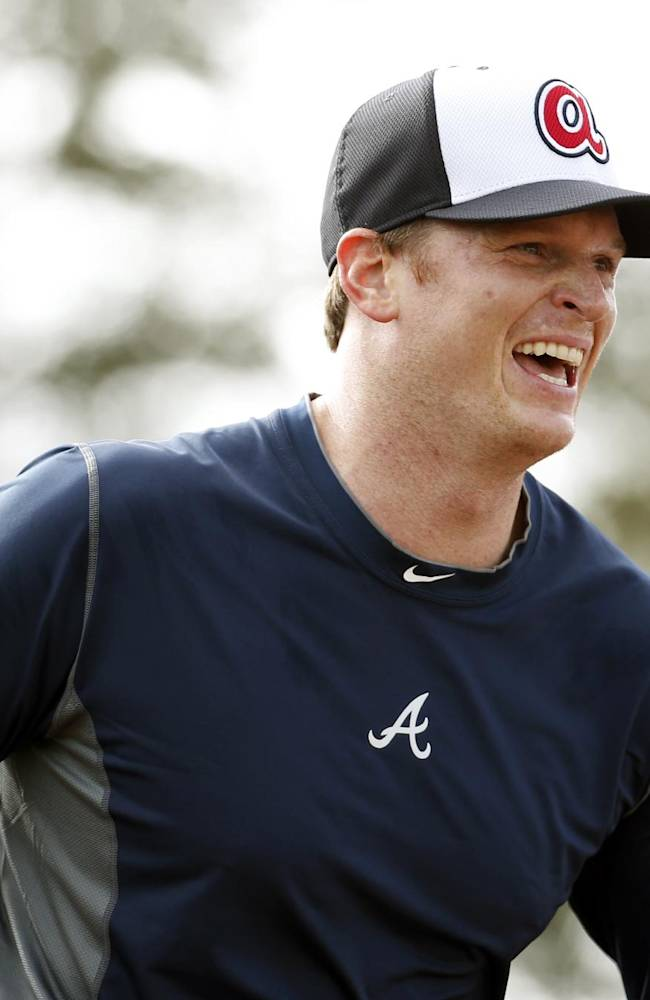 Atlanta Braves pitcher Gavin Floyd smiles during a spring training baseball workout, Thursday, Feb. 13, 2014, in Kissimmee, Fla