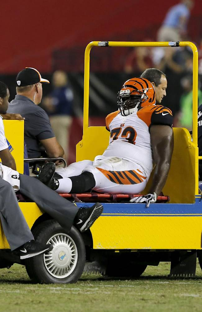 Cincinnati Bengals guard Trey Hopkins (73) is carted off the field after being injured against the Arizona Cardinals during the second half of an NFL preseason football game, Sunday, Aug. 24, 2014, in Glendale, Ariz. The Bengals won 19-13