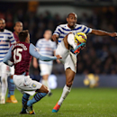 Queens Park Rangers' Karl Henry, right, and Aston Villa's Ashley Westwood battle for the ball during the English Premier League match at Loftus Road, London, Monday, Oct. 27, 2014
