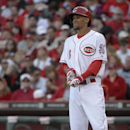 Cincinnati Reds' Billy Hamilton stands at home after striking out against St. Louis Cardinals starting pitcher Adam Wainwright to end the seventh inning of a baseball game, Monday, March 31, 2014, on opening day in Cincinnati. Hamilton struck out four tim