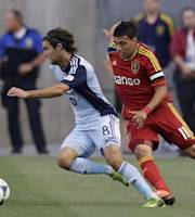 Real Salt Lake's Javier Morales (11) defends against Sporting Kansas City's Graham Zusi (8) in the first half of an MLS soccer game Saturday, July 20, 2013, in Sandy, Utah. (AP Photo/Rick Bowmer)