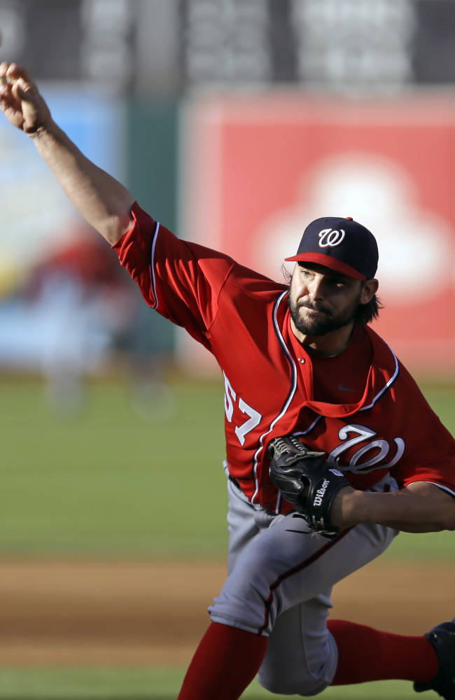 Washington Nationals' Tanner Roark works against the Oakland Athletics in the first inning of a baseball game on Saturday, May 10, 2014, in Oakland, Calif