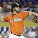 Haren escapes repeated jams to help Marlins beat Reds 8-1 The Associated Press