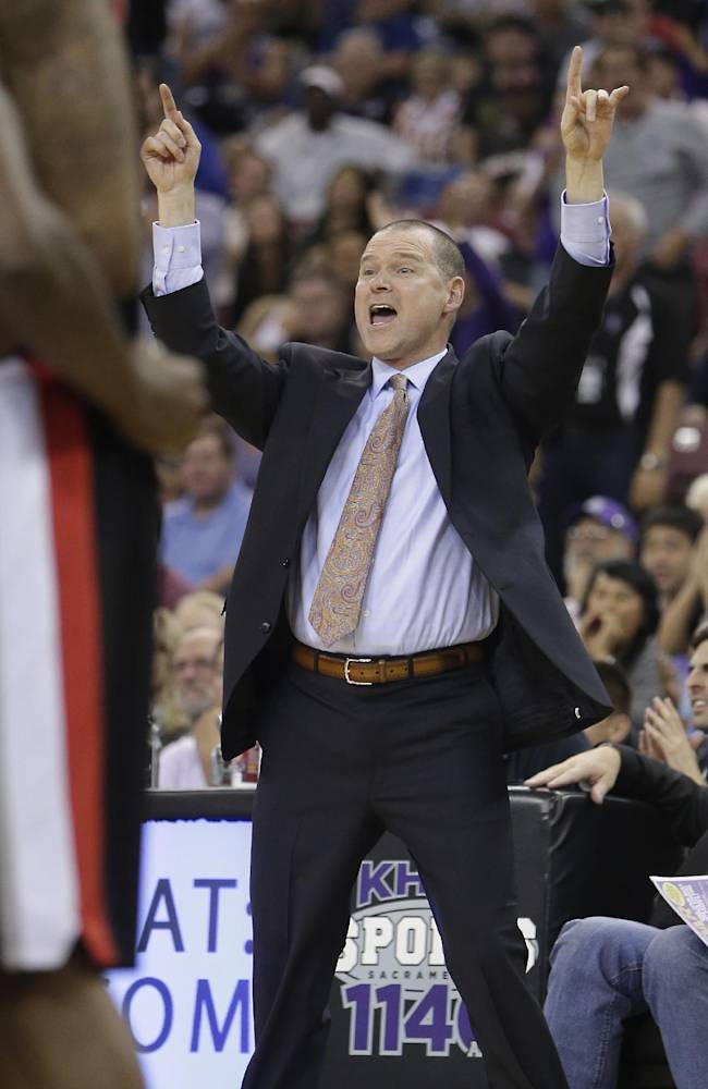 Sacramento Kings head coach Michael Malone shouts out directions to his team during the fourth quarter against the Portland Trail Blazers, in an NBA basketball game in Sacramento, Calif., Saturday, Nov. 9, 2013.  The Trail Blazers won 96-85