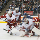 Detroit Red Wings goalie Jonas Gustavsson (50) stops a Toronto Maple Leafs shot during second-period preseason NHL hockey game action in Toronto, Friday, Oct. 3, 2014 The Associated Press