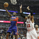 Detroit Pistons forward Greg Monroe, left, drives to the basket against Chicago Bulls forward Taj Gibson during the first half of an NBA basketball game in Chicago on Friday, April 11, 2014 The Associated Press